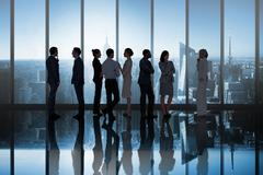 Composite image of business colleagues talking - stock photo