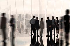 Stock Photo of Composite image of business colleagues standing