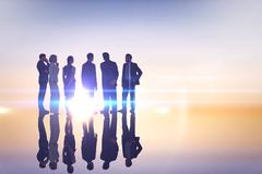 Composite image of business colleagues standing Stock Photos