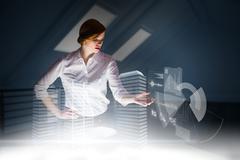 Composite image of redhead businesswoman using interactive desk - stock illustration