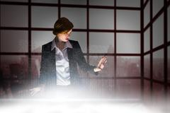 Composite image of redhead businesswoman using interactive desk Stock Illustration