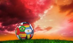 Composite image of football in multi national colours - stock illustration