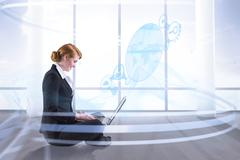 Composite image of redhead businesswoman using her laptop Stock Illustration