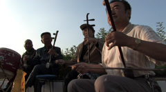 villagers playing Chinese traditional music instrument Erhu - stock footage