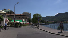 Italy, lake Como and embankment of town Como. Panning left to wright. Stock Footage