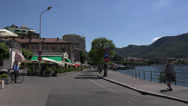Stock Video Footage of Italy, lake Como and embankment of town Como. Panning left to wright.