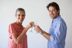 Stock Photo of Casual successful business team toasting with champagne