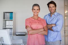 Casual confident business team smiling at camera - stock photo