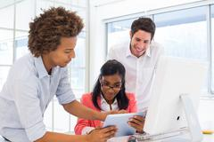 Stock Photo of Casual colleagues working hard together