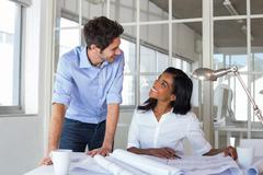 Architects communicating happily about work - stock photo