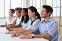 Business people attentive at presentation - stock photo