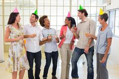 Coworkers laugh and celebrate accomplishment and enjoy party Stock Photos