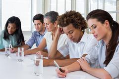 Business people taking down important notes - stock photo