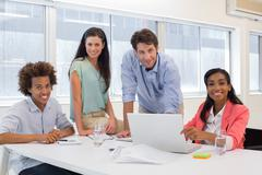 Stock Photo of Attractive business people working together