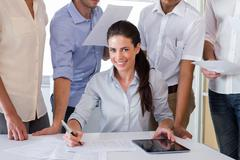 Stock Photo of Attractive businesswoman smiling in the workplace