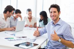 Stock Photo of Attractive businessman smiling in the workplace