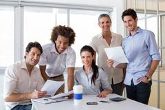 Attractive business people smiling in the workplace - stock photo