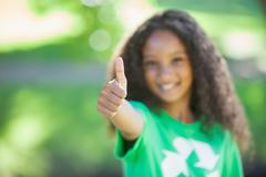 Young environmental activist smiling at the camera showing thumbs up Stock Photos