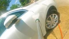 Car pressure jet washing pov. worker washing car. manual car washing cleaning Stock Footage
