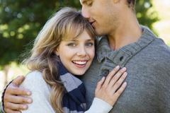 Stock Photo of Cute woman smiling at camera with her boyfriend