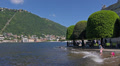 Italy, lake Como, children playiong on embankment. Footage