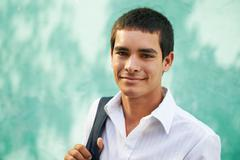 college student-portrait of young man smiling - stock photo