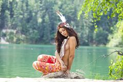 Young woman in costume of american indian Stock Photos