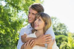 Stock Photo of Cute couple hugging in the park