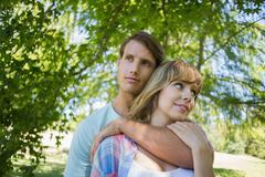 Stock Photo of Cute affectionate couple standing in the park together