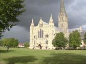 Stock Video Footage of Cathedral Church, Salisbury Cathedral - west front + tilt up spire