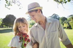 Stock Photo of Attractive blonde holding roses standing with partner