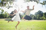 Stock Photo of Cute couple jumping in the park together