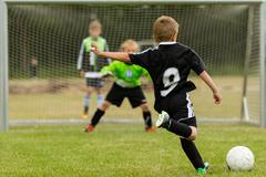 kids soccer penalty kick - stock photo