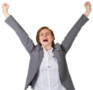 Stock Photo of Excited redhead businesswoman cheering