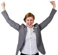 Excited redhead businesswoman cheering - stock photo