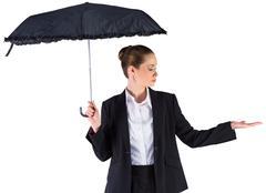 Stock Photo of Businesswoman holding a black umbrella