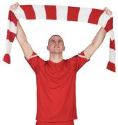 Stock Photo of Football player holding striped scarf