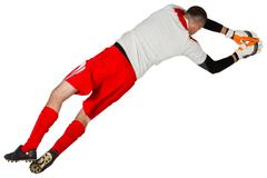 Stock Photo of Fit goal keeper jumping up