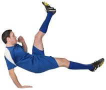 Football player in blue kicking - stock photo