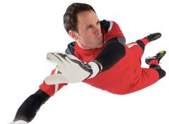 Fit goal keeper jumping up - stock photo