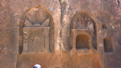 Medium shot of rock carvings at Tombs of the Kings Stock Footage