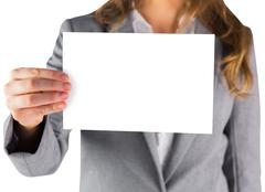 Stock Photo of Businesswoman showing a blank card