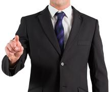 Stock Photo of Businessman in suit standing and pointing