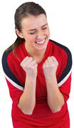 Stock Photo of Excited football fan in red cheering