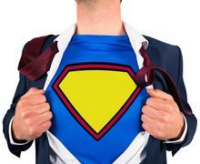 Businessman opening shirt in superhero style Stock Photos