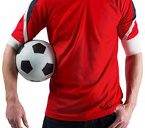 Football fan in red holding ball - stock photo