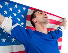 American soccer fan holding flag Stock Photos