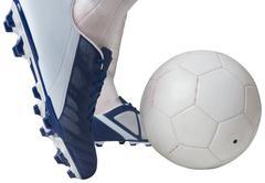 Close up of football player kicking ball Stock Photos