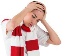 Disappointed football fan looking down Stock Photos
