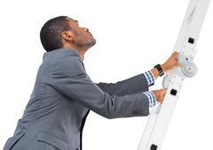 Stock Photo of Businessman climbing up ladder